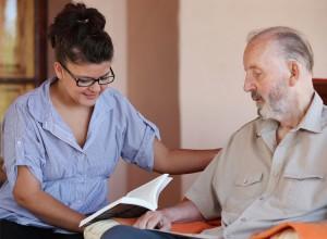 hospice volunteer reading to patient